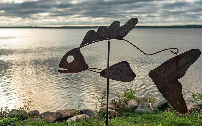Wally, Water's Edge Metal Art metal fish sculpture on lake shore